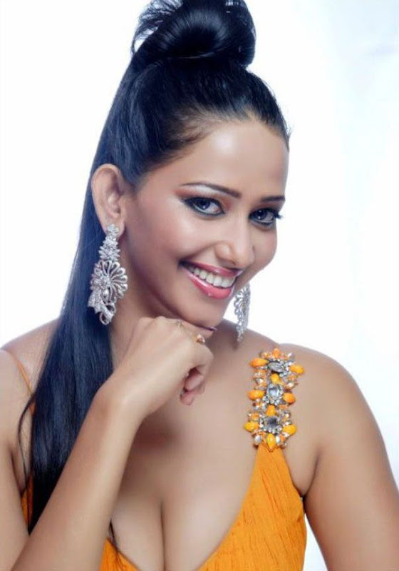 Actress Sanjana from Tollywood Showing her Cleavage in a Orange Long Gown