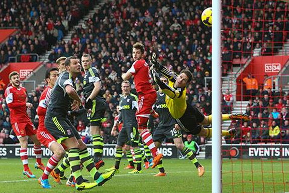 Southampton player Rickie Lambert scores his team's opening goal against Stoke from a free-kick