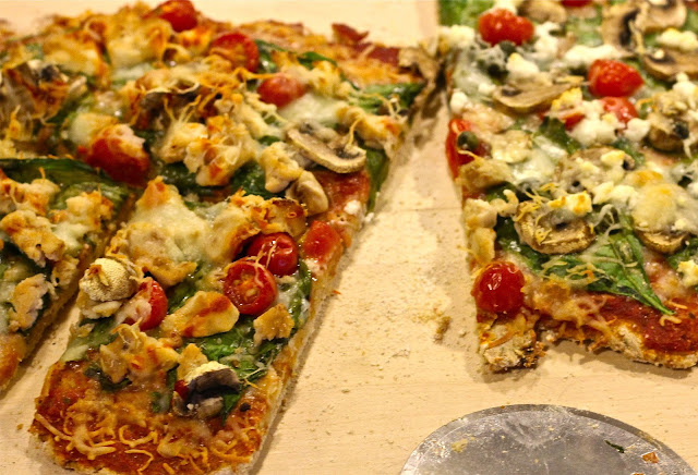 A sliced wholewheat pizza made from freshly milled wholewheat on www.anyonita-nibbles.com