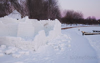 boardwalk at Couchiching Beach Park in winter snows showing the remains of the Orillia Winter Carnival snow castle, Orillia, Ont