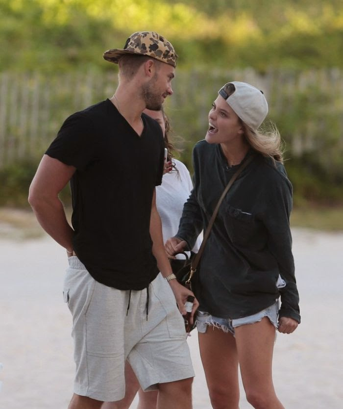 All that spit swapping for this reality at the beach in Miami, FL, USA on Saturday, November 29, 2014.  Nina Agdal and boyfriend, Reid Heidenry hit a local beach as they were snapped to making out and sharing a difficult story for many male eyes in the world.
