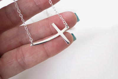 sideways cross necklace meaning