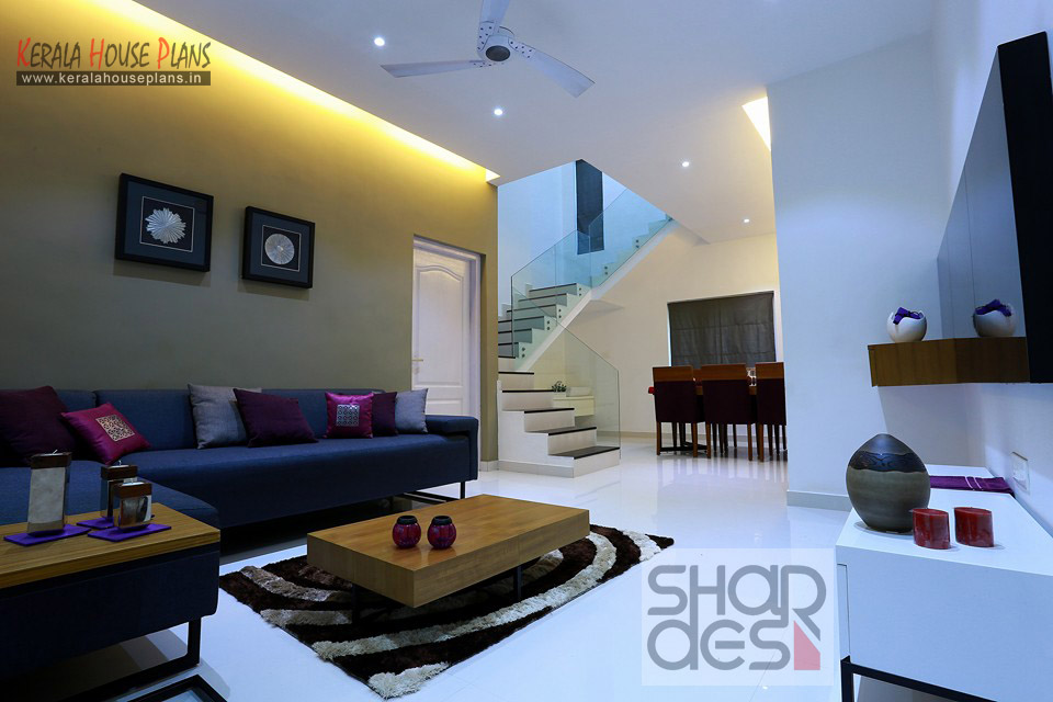 Kerala style living room interior designs kerala house for Interior design for living room roof