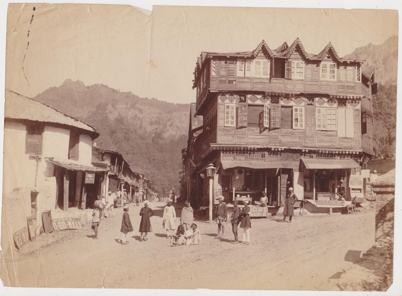 Group of People in front of a Watch Shop - c1870's