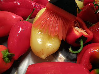 Silicon brush on yellow and red peppers