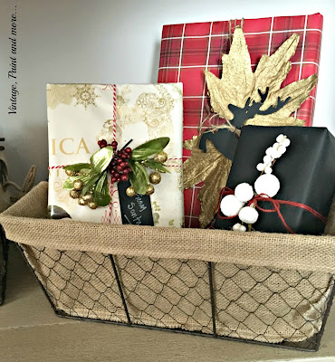 diy wrapped gifts with naturals embellishments in burlap lined vintage wire basket