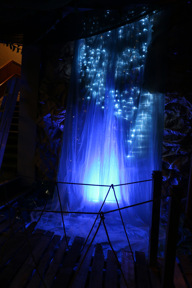 Waterfall made by layering shiny blue taffeta with white tulle and christmas lights