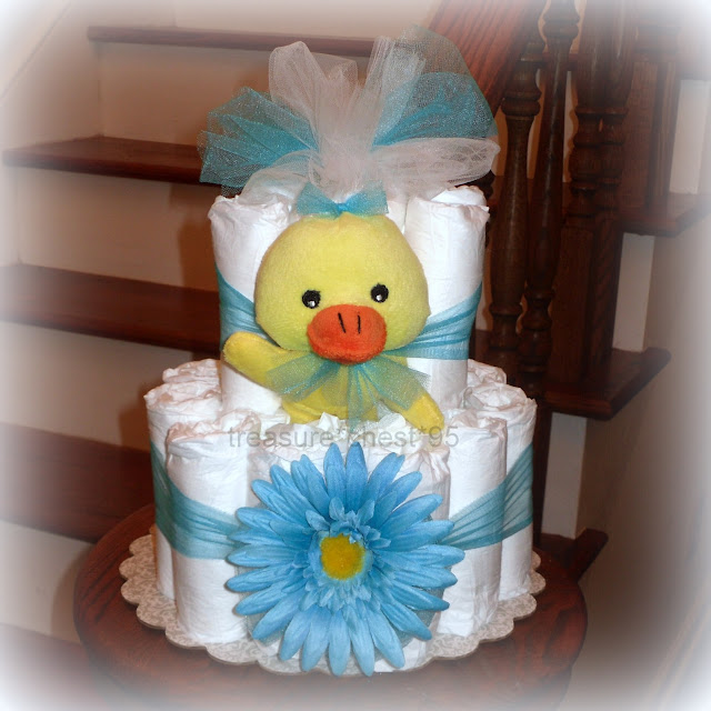 Daisy duck diaper cake baby shower centerpiece for Baby shower decoration diaper cake