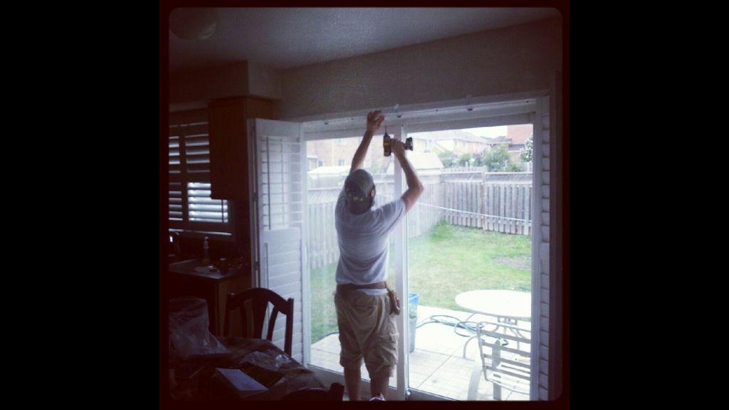 Enrico on patio door shutter installation in Toronto