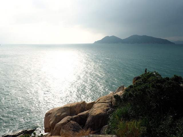 Ocean view towards Shek Kwu Wan Island at sunset from Reclining Rock on Cheung Chau Island, Hong Kong