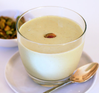 with a pistachio custard sauce. The cold sauce is served alongside the ...