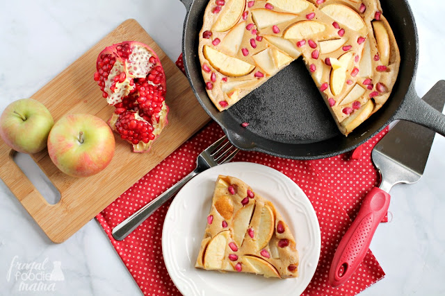 A thick buttermilk pancake is studded with juicy pears, sweet apples, and jewels of pomegranate seeds & baked to a golden brown in your cast iron skillet in this Apple-Pear Pomegranate Puff Pancake.