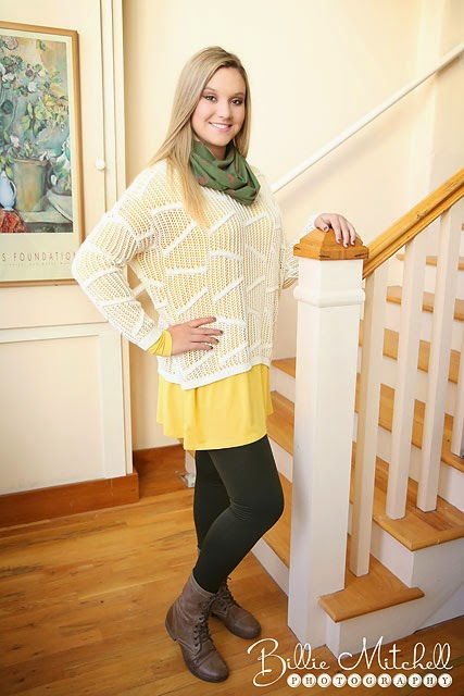 blonde girl wearing white sweater with long yellow tunic underneath and green scraf and leggings