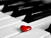 Música de amor. En este wallpaper aparece un pequeño corazón de color rojo . (musica de amor)