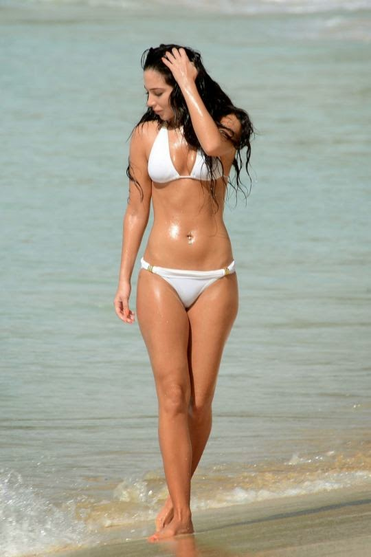 Tulisa Contostavlos spotted in a white bikini on Barbados beach