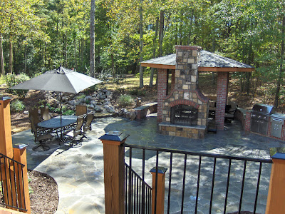 oversized backyard fireplace waterfall