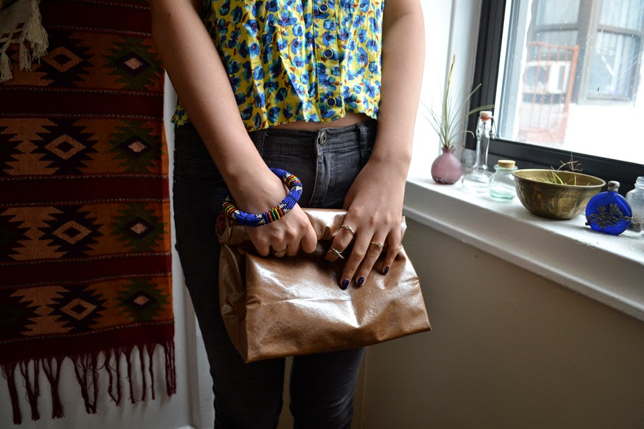 http://www.allthegoodgirlsgotoheavenblog.com/basic-blog-mode/2014/2/12/diy-no-sew-leather-paper-bag-clutch