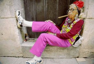 old-lady-on-doorstep-with-cigar-300x2072