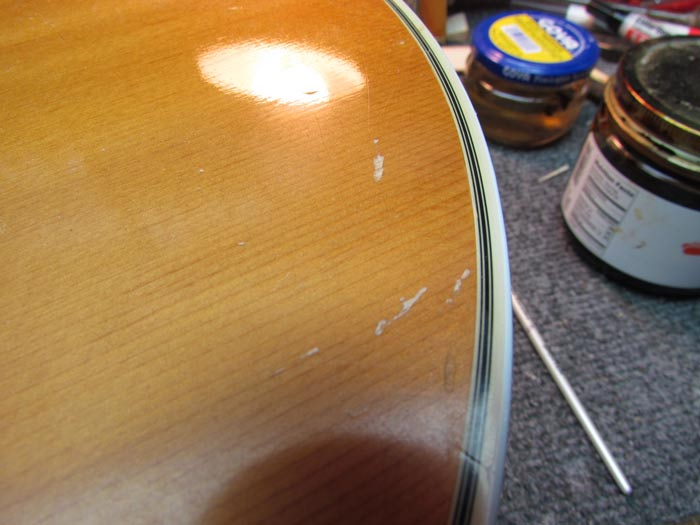 how to clean nitro finish guitar
