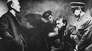 Mundt takes Alec Leamas into custody in The Spy Who Came in from the Cold, Directed by Martin Ritt