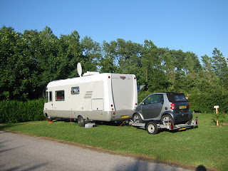 Large motorhome with small car on trailer, France 2005