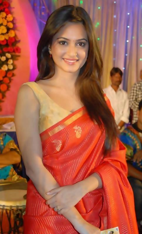 Kriti Kharbanda Spicy Navel Show Stills In Orange Saree