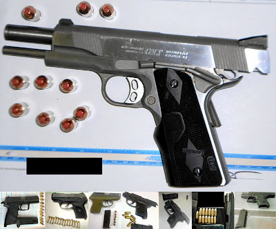 Loaded guns discovered in carry-on bags.