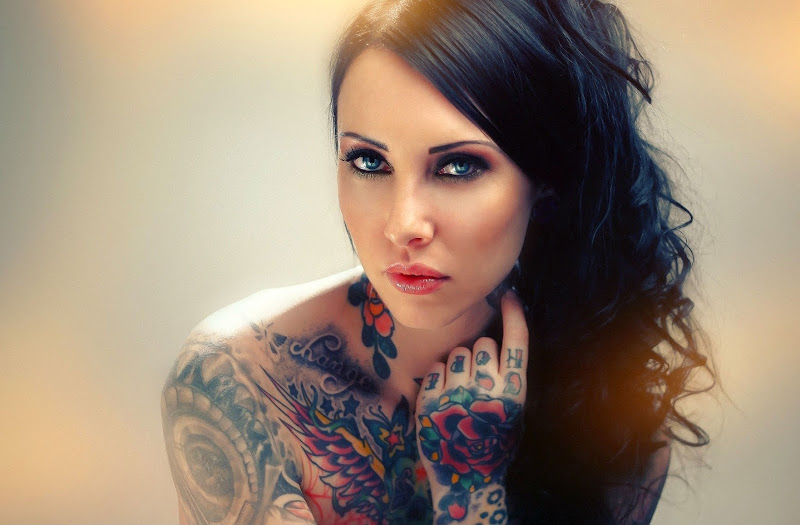 Tattooed Women Wallpaper title=