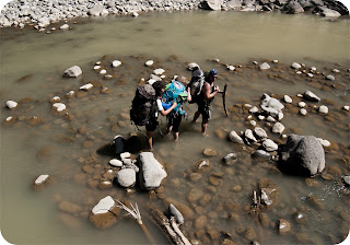Jae, Ruth and Jim crossing the river