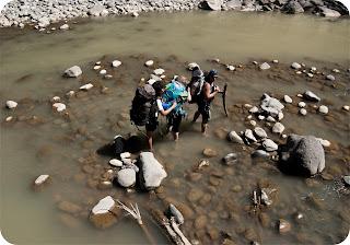 Jae, Ruth and Jim crossing the river