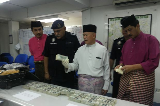 City police chief SDCP Datuk Mohmad Salleh (middle, in white) looking