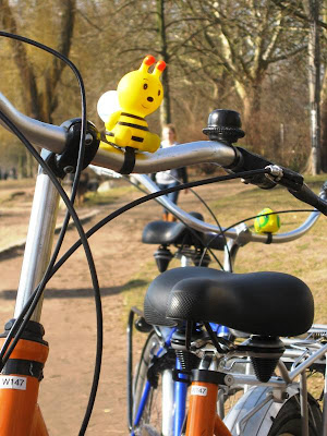 Toy bee on bicycle handlebars