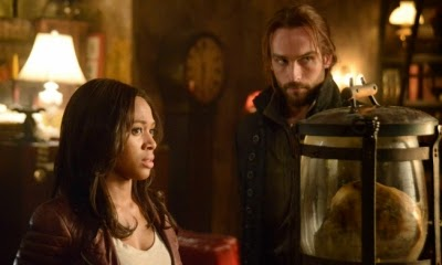 Lt. Abbie Mills (Nicole Beharie) and Ichabod Crane (Tom Mison) in SLEEPY HOLLOW, created by Phillips Iscove, Roberto Orci, and Alex Kurtzman