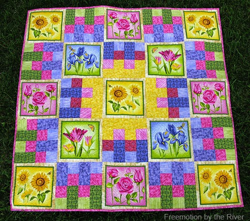 Flower Garden Quilt on the grass at Freemotion by the River