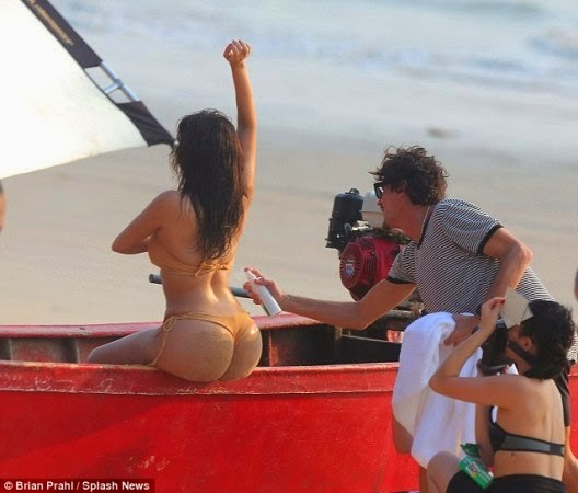 Photo 9 Kim Kardashian Flaunts Her Butt in Tiny Bikini for Beach Shoot