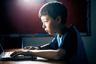 Picture of 10 year old Matthew Carpenter at his computer on KhanAcademy.org learn trigonometry problems