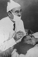 doctor is performing a lobotomy as treatment for his mentally ill patient
