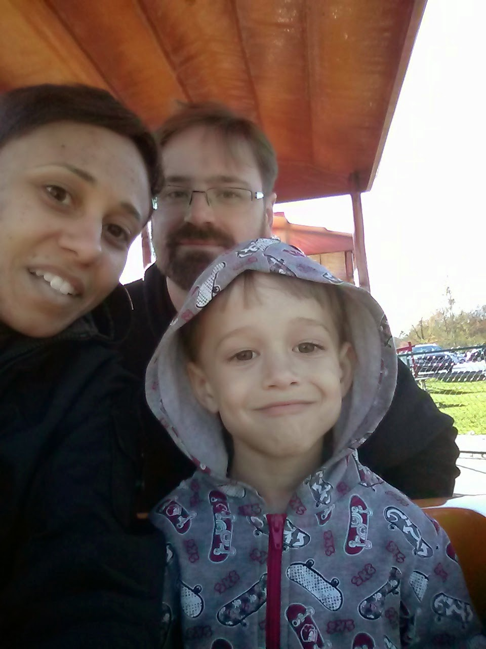 family selfie on Big Apple train Colborne, ON copyright 2014 OneQuarterMama.ca