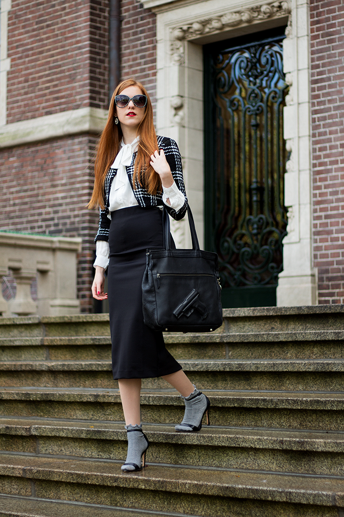 Socks in sandals fashion blogger outfit with midi skirt and cropped jacket in Amsterdam