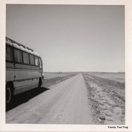 Bus on side of road on flat terrain