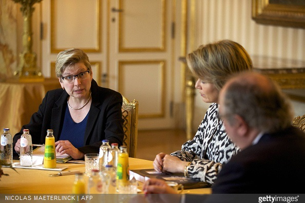 Belgian State Secretary for Poverty, Fraud and Science Elke Sleurs and Belgium's Queen Mathilde attend a presentation on poverty at the Royal Palace
