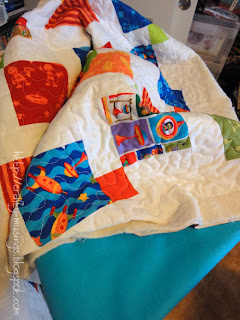 Bot Camp baby quilt ready for binding