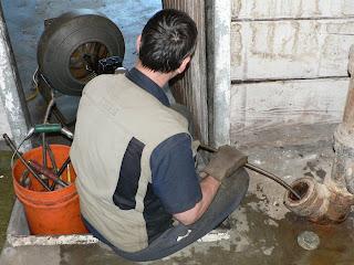 plumber's snake going into main line
