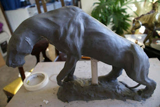 sculpting a lion, sculpting a clay mountain lion sculpture, sculpting a clay panther sculpture
