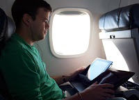 traveling, watching movies, ipad, tablet, headphones, earbuds, airplane