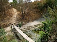 La passera sobre el Gurri, a l'alçada de Can Serraïma, vista des del cantó de Vic