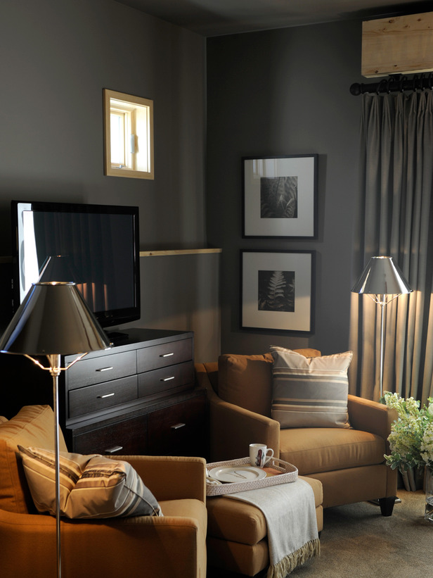 Touches Of Metallics Brighten The Space Which Features Dark Walls And