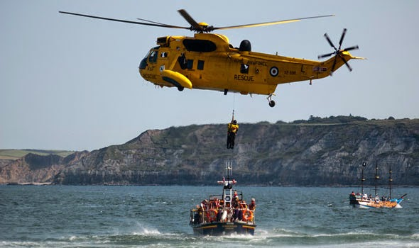 Sea King from RAF Leconfield winching a man up from the Scarborough lifeboat.