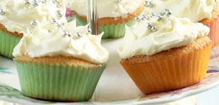 Lemon cupcakes with lemon icing. Classic cupcakes topped with lemon icing (frosting) and decorated with silver balls.
