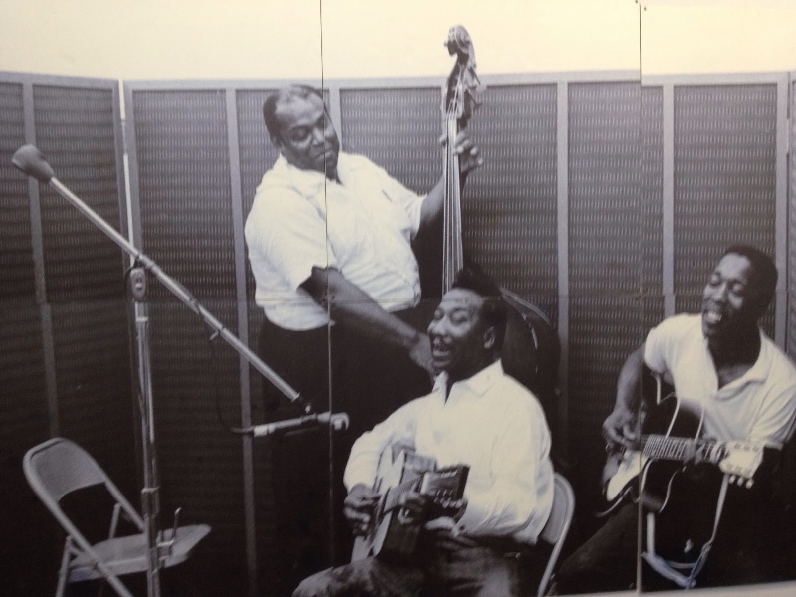 Muddy Waters center, Junior Wells left, Willie Dixon standing